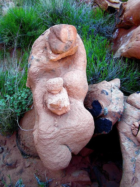 """Mother and Child"" Red sandstone boulder. Mohave desert. Nevada 2005. (Next time I visited, somebody had thrown the small 'head' rocks away. It must have been altered adding the 'head' rocks before. The Baby is original weathered out part! Last time I found all the small rocks gone and it looked now like Klimt's famous ""Goldfische""  In the desert... people do much damage by playing and messing up nature!"