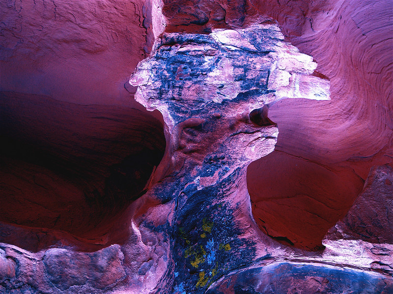 The Angry Devil in His Element. Homage to Edward Hirsch.  Red/blue sandstone cave when wet after rain. A.V.