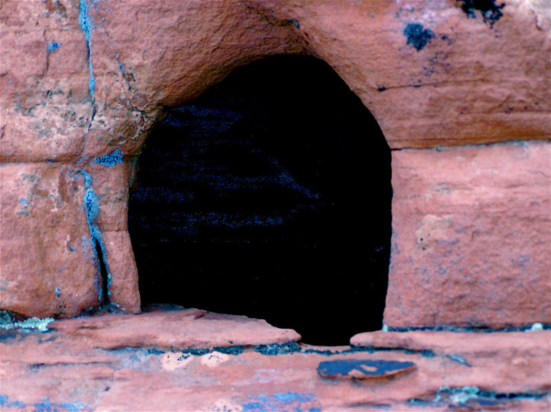 """Gateway to Malevich.  Entrance into a dark Cave. """"Homage to Kasimir<br /> > Malevich I."""" Pink sandstone. North of Lake Mead. Nevada. 2004."""