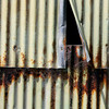 Not only does this image have wonderful rust tones and shapes, but the bent siding adds a nice diagonal to the otherwise strong verticals of the image.