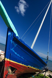 Colorful boat on the shores of Dangriga, Stann Creek, Belize, Central America.