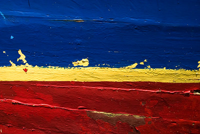 Close up of bands of color on boat in Dangriga, Stann Creek, Belize, Central America.