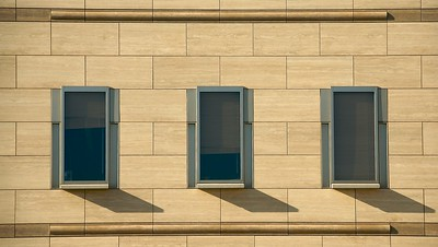 Three windows on Braun at Caltech.  The travertine panels are like those at The Getty Museum.