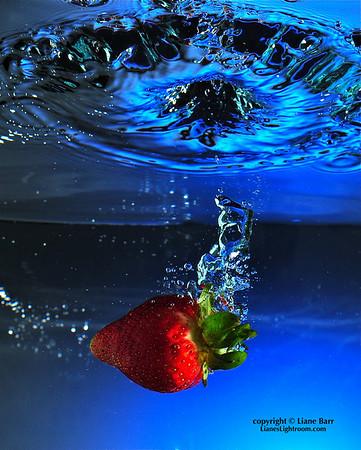 Strawberry Splash.  (Still life photography)