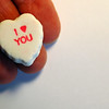 I love You white Candy Heart in a hand on White Background