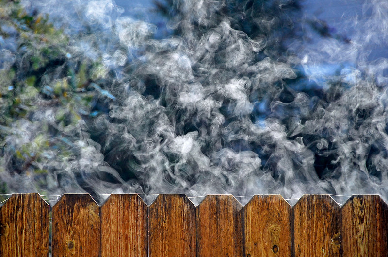Frost melting on fence