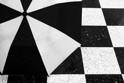 Once on a business trip to New York I went to see some folks at Columbia University on a rainy day.  I found the interplay of the umbrella and floor patterns quite irresistible!
