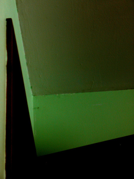 This is the corner of the walls and ceiling in my bedroom, with the door partially open.  I liked the color blocking and geometric shapes.  I pulled a lot of mid-tone color out and bumped up the contrast.