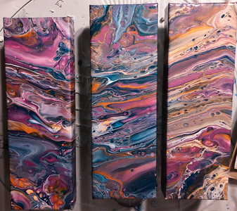 SOLD. $90 . 3 flip cup acrylic pour paintings on 12x4 in.  deep sided canvas .with resin coating.