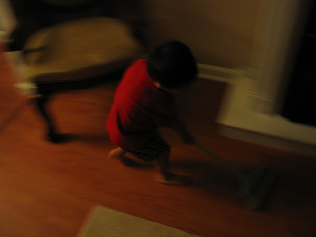 My nephew always wanting to help out.  So he is resweeping after his mom swept the floor.