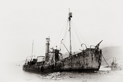 The mysterious whaling ship Petrel, built in 1928 and abandoned off of Grytviken in South Georgia.  Her harpoon can be clearly seen off the bow.
