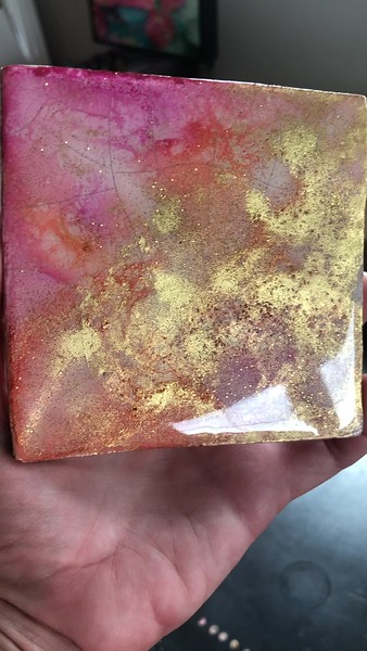 Practice coaster with  cracks in the porcelain. Practiced with different glitters.