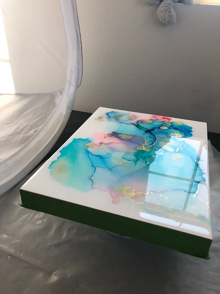 Student artwork with resin pour in the drying phase