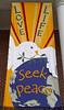 """""""Love Life, Seek Peace"""" banner made by Mary Lou Cummings & me, 2003. With added paint."""