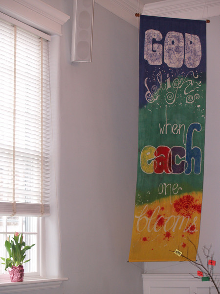 """God delights when each one blooms"" batik banner,   © Anna Lisa Yoder.  Made for Perkasie Mennonite Church."