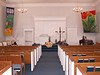 """""""God delights when each one blooms"""" and """"Tulip with Pushkinia"""" batik banners in Perkasie Mennonite Church."""