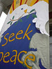 """""""Love Life, Seek Peace"""" banner made by Mary Lou Cummings & me, 2003 .   Detail, with added paint."""
