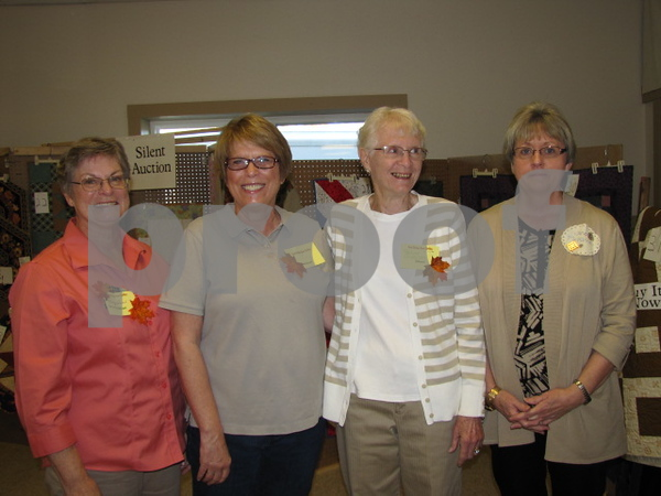Mary Ann Corcoran, Nancy Riehl, Paulyne Anderson, and Janet McKinney of the Fort Dodge Area Quilters worked at the silent auction booth.