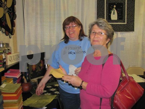 Donna Jensen of 'Prairie Woolens' explains her technique to Debbie Sankey of Algona.