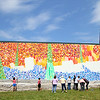 Clients, their family members and staff of the Arc of Opportunity participated in helping paint Caleb Neelon's mural on the side of the Arc of Opportunity building. SENTINEL & ENTERPRISE/JOHN LOVE