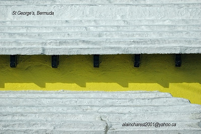 White roof on yellow wall