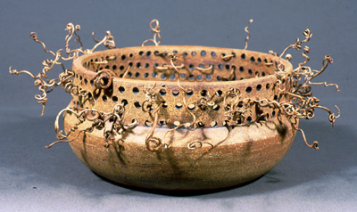 Ceramic class offered each semester. Cerramic bowl with fibers.
