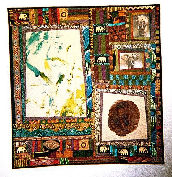 """Malika's Quilt""<br /> 2004  - 42"" x 56"" <br /> Malika is an elephant who lives at 6-Flags MarineWorld in Vallejo, CA. The green and yellow panel on the left of the quilt was painted by her as she held a brush in her trunk. Her photos are on the upper rignt of the quilt, and the blob on the lower right is her foot print. The quilt was sold at the 2004 ""Animal Instincts"" auction to raise money for the Vallejo Community Arts Foundation.<br /> See the album entitled ""Mailika the Elephant"" for photos of the making of this quilt."