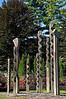 """Arborous Nine 02<br /> Harry Wheeler (carved wood, 1979)<br /> OOSI: """"Description: Nine shafts of wood carved into various shapes. Intended to represent """"the spirit of art, life and the yearning of the earth to spring forth with multitudinous forms of delight,"""" according to the artist. The individual dimensions of the nine pieces are: 9'7"""", 9'8"""", 10'6"""", 11'2"""", 15'(2), 19'.""""<br /> .<br /> Entrance, Toledo Botanical Garden, Ohio<br /> September 19, 2012"""