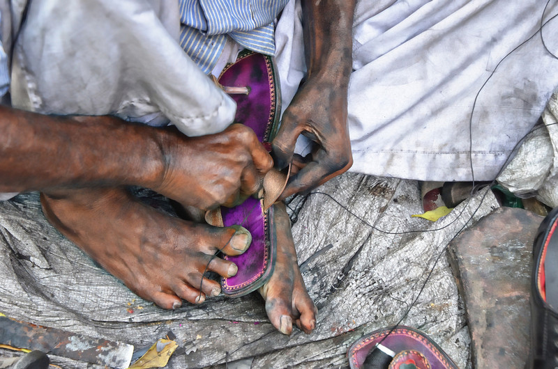 Street side cobbler in New Delhi, India