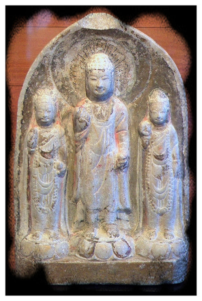 Buddha flanked by two bodhisattvas.