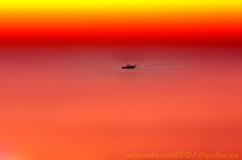 Alone at sea on a warm evening