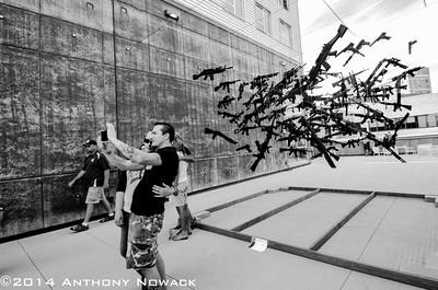 """Guy taking this selfie had gun tattoos and a shirt that said """"Bring Enough Guns"""". I wonder if he thinks this is enough guns."""