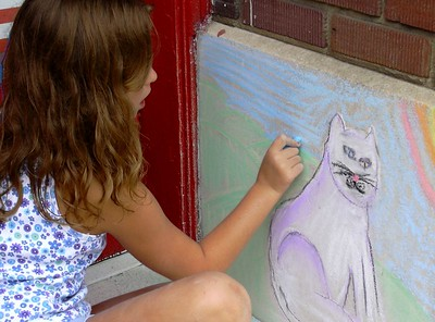 Modern ARF Sidewalk Chalk Painting: One of the most talented young artists from N. Virginia draws a portrait of the Museum mascot, W.G. Photo: Roger Cutler