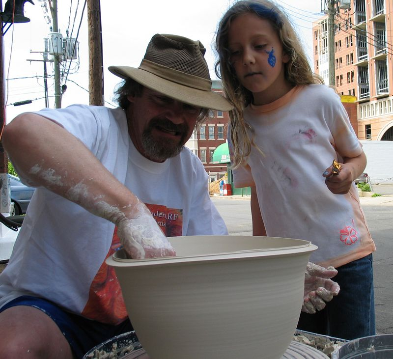 """Art-In-Action: Young chalk artist observes """"Two ways to 'throw' a BIG pot"""" pottery demonstration, Modern ARF.  The same piece was then thrown OFF the roof onto the sidewalk next to the potter's wheel, traveling 36 feet  to the ground. Photo: Andrea Scharnau"""