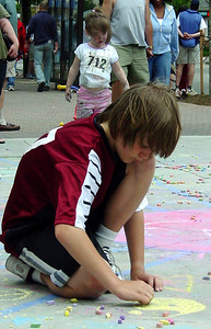 """Young artist practicing up for CHALK4PEACE """"Giant Bike Tire"""" CSC Clarendon Cup Bike Race, VA  6/06"""
