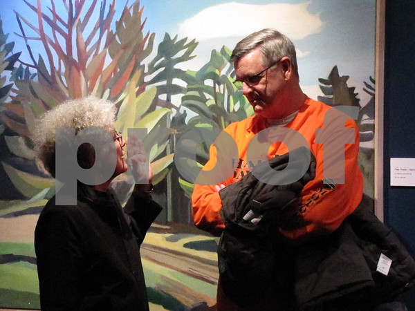 Visiting artist Martha Armstrong visits with local artist Richard Hanson after Armstrong's talk.
