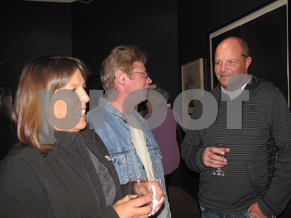 Jackie Cockrum, Ron Auten, and Andrew Cockrum visit during the reception for their relative Gerald Auten.