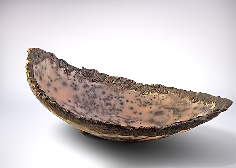 Naked Raku dish with foot