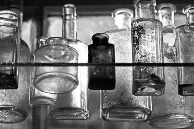 glass bottles with red BW