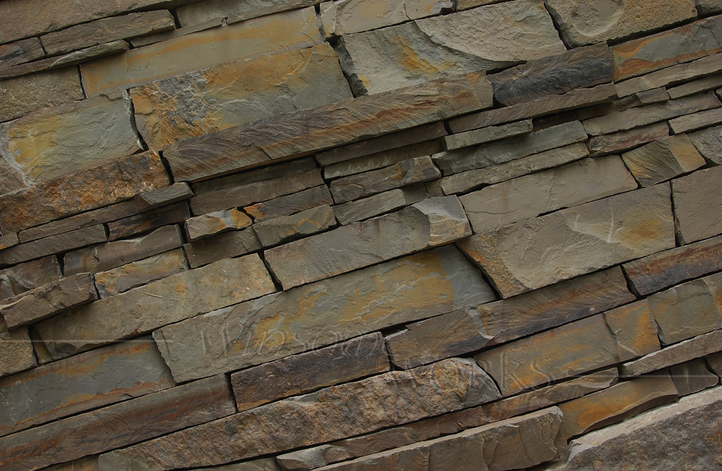 Rock layers of retaining wall at Teardrop Park in lower Manhattan