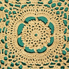 Hand-crocheted Lace on Green Background