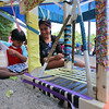 Kunal Kaw, 5, and his mother Geetika Kaw, of Bedford, decorate a temporary structure for Art in the Park day at Springs Brook Park in Bedford. (SUN/Julia Malakie)