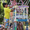 Vivek Kaw, 8, of Bedford, decorates a temporary structure for Art in the Park day at Springs Brook Park in Bedford.    (SUN/Julia Malakie)