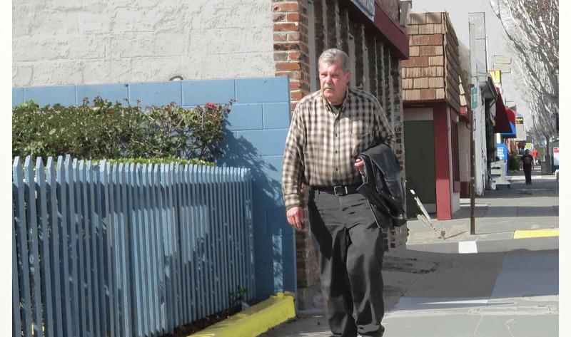 pedestrian w blue picket fence