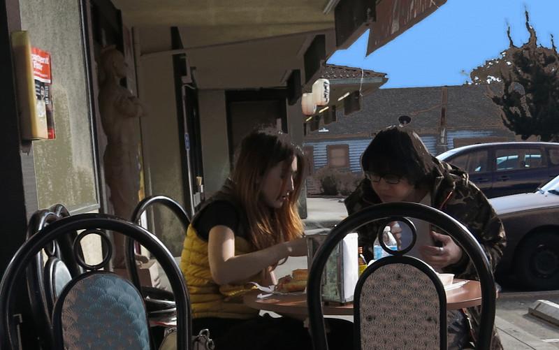 couple at vietnamese sandwich cafe