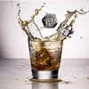 Ice splashing into a whiskey glass - the composite without the cleanup.