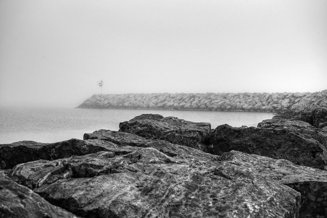 Breakwater In Fog