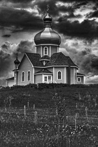 Church on the Hill ~ During a June trip to Alberta, Canada, I visited the Ukraine Heritage Cultural Village.  This was my favorite church there, and I liked it in color, yellow, with a metallic dome roof.  I decided to try it in black and whilte as well, and liked the result.                             Judith Sparhawk