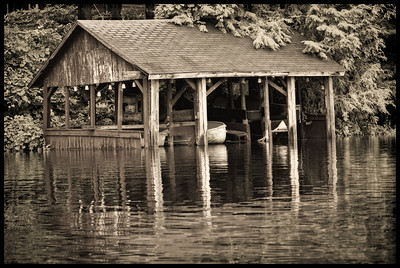 Lakeside boathouse black and white