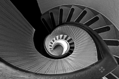 "Down the Up Staircase ~ This title is a play on the old novel from the 1960's--or 70's ?--""Up The Down Staircase"".  This is a view looking down the spiral staircase at the Old Point Loma Lighthouse at Cabrillo National Monument in San Diego, California."